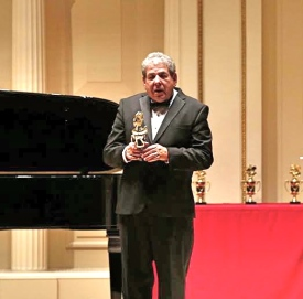 John receiving award at Carnegie Hall